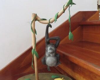 Monkey with banana and turtle