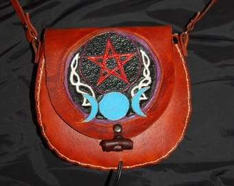 Pagan hand carved and stitched handmade leather bag using veg tan leather
