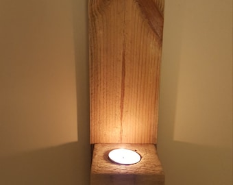 Wall mounted reclaimed wood candle holder