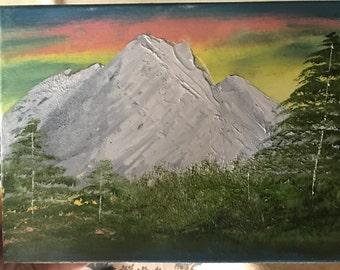 Mountain range with rainbow sky