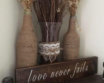 Love never fails- wooden sign