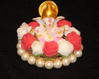 Ganesha Statue with floral arrangement