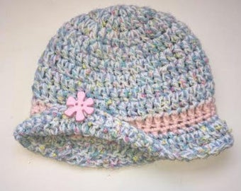 rainbow hat with flower accent