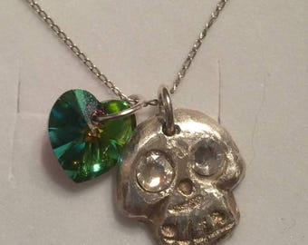 Hand made Swarovski crystal and silver voodoo luck charm.