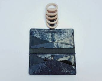 Leather patent leather wallet made by hand.