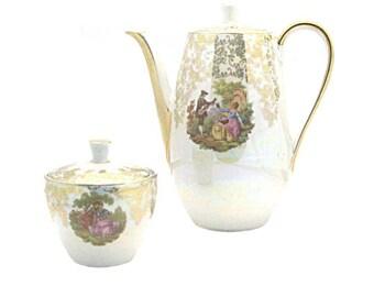 Superb coffee pot and sugar bowl real porcelain