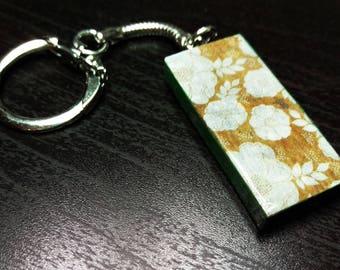 Flora Domino Keychain