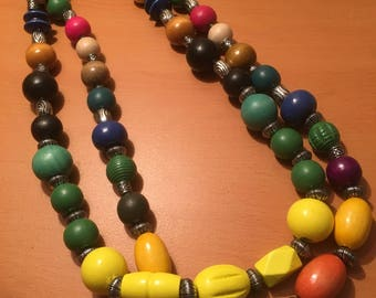 A double stranded beaded necklace made of multisized and multicolored wooden beads