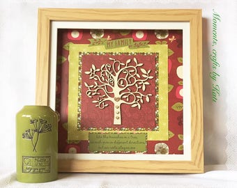 Box frame with wooden family tree and red and green patterned background