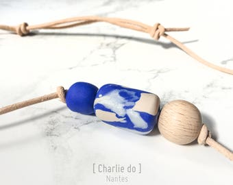 Leather, polymers and wood beads necklace