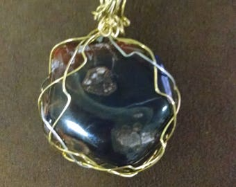 gold and silver accented wrapped pendant