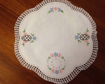 Vintage hand embroidered doily, 25 cm round, pink and blue padded small flowers