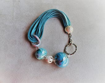 Ceramic beads blue and turquoise Stretch Bracelet with hand made suede cord