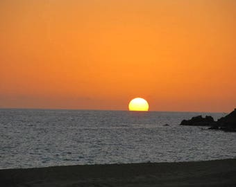 sun setting over the beach in cabo san lucas