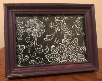 Picture in distressed frame