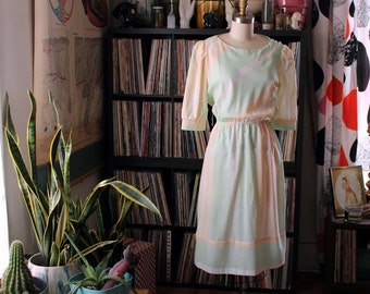 1980s dress . pastel sherbet striped dress with elastic waist and puffed sleeves . pale green and tangerine orange . medium large