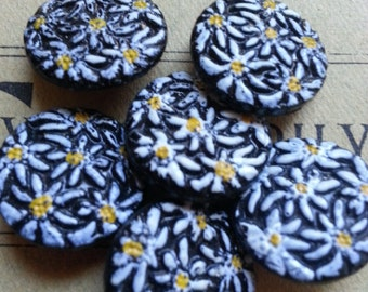 "Last Ones .... SIX Medium, Daisy Flowers on Black Glass, Buttons. Vintage. Measure about 3/4""."