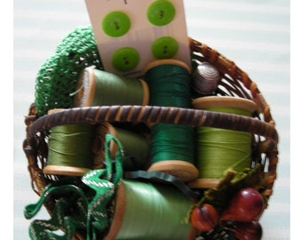 Basket of Sewing Memorabilia with Vintage Wooden Spools of Green Thread