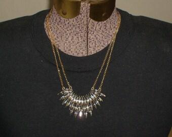 Super fancy bib cresent necklace. Statement piece, very sparkly. Great wedding piece