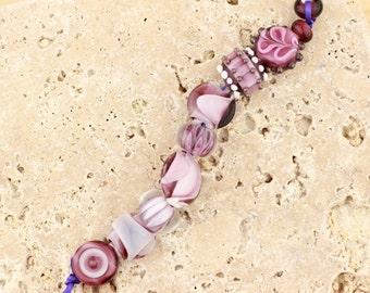 mix of purple delight, lampwork beads, firefrost studio