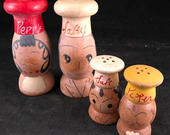 Two (2) Sets of Vintage Wooden Salty & Peppy Chefs Salt and Pepper Shakers (One Large Set and One Small Set)