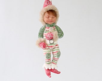 Sleeping Baby Elf Ornament. Green red striped outfit red shoes red hat glitter baby's first Christmas