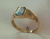 10kt Yellow and White Gold Emerald Cut Blue Topaz Ring