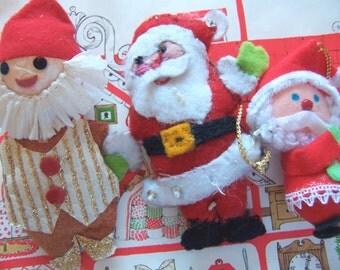 three felt and paper ornaments