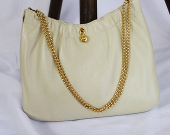 CREAM COLORED PURSE by Ande