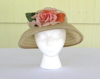 1950's wide brim flower pot style natural straw hat with dotted netting, pink flower, paste brooch decoration