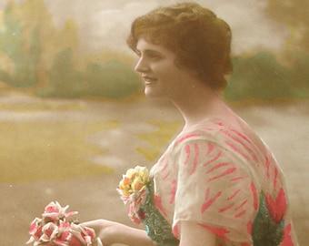 1900s French postcard Edwardian lady with flowers,  RPPC real photo, paper ephemera.