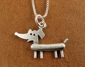 Tiny dachshund necklace / pendant