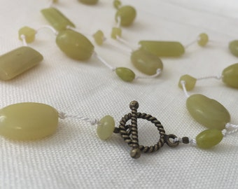 yellow jade necklace with brass clasp