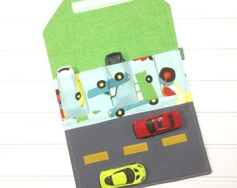 The ultimate travel car wallet gift for kids. Great for toy storage, wedding favors, or birthday parties. Perfect on the go travel mat.