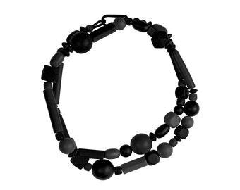 Long black geometric bead necklace, handmade by Frank Ideas