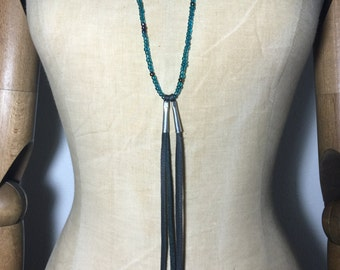 Gemini beaded necklace in teal with leather