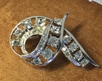 Stunning Signed Coro Clear Rhinestone Silver Tone Swirled Ribbon Brooch Pin 1950's 1960's Rhodium Plated Eye Catching Splendor Feminine