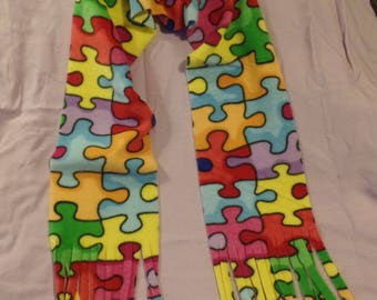Puzzle pieces fleece scarf with fringe Apprx 60 inches long X 6 inches wide Multi-colors