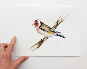 original ink and watercolor painting of a goldfinch