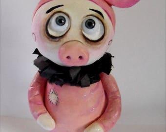 Grimmy dans une poupée de costume de cochon