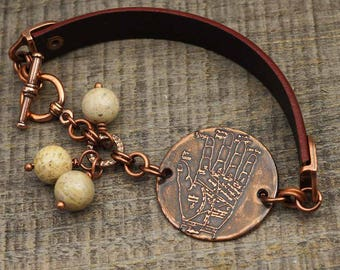 Palmistry jewelry, copper and leather bracelet, palm hand metal etching, light brown fossil coral beads, 7 3/4 inches long