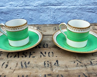 Vintage set of two green and gold tea / coffee cups