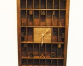 A clock set in a part printer's wooden type case - also for display, thimbles,etc