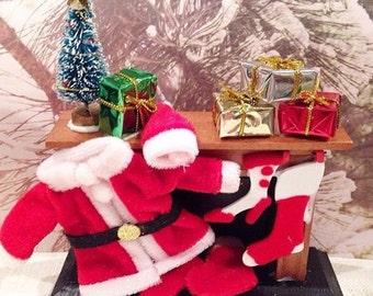 Handmade hand decorated miniature Christmas fireplace.