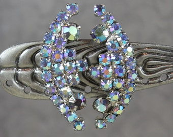 Vintage 1950s to 1960s Baby Blue Aurora Borealis Rhinestone Curved Clip On Earrings