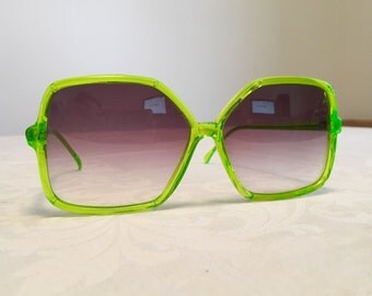Green vintage sunglasses, oversized seventies shades, neon green plastic, gradient lenses, tinted lenses, lime, eyewear, made in Hong Kong