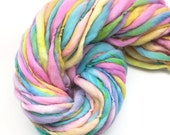 Handspun super bulky yarn, 54 yards and 3.2 ounces, 90 grams, spun super chunky, thick and thin in pastel rainbow  merino wool
