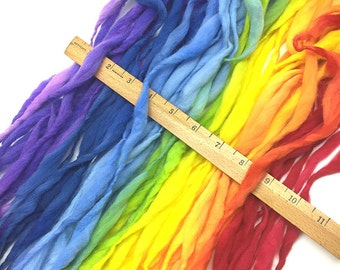Super bulky handspun rainbow yarn, 58 yards and 3 ounces/ 85 grams, spun thick and thin in self striping merino wool