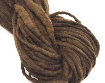 Hand spun felted yarn, spun thick and thin in merino wool - 24 yards and 1.8 ounces/51 grams