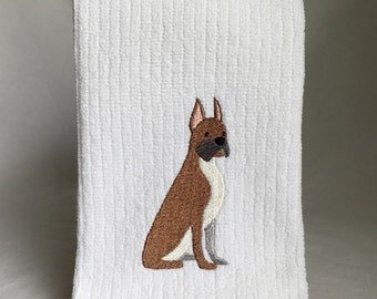 Brown Boxer on white vertical bar towel